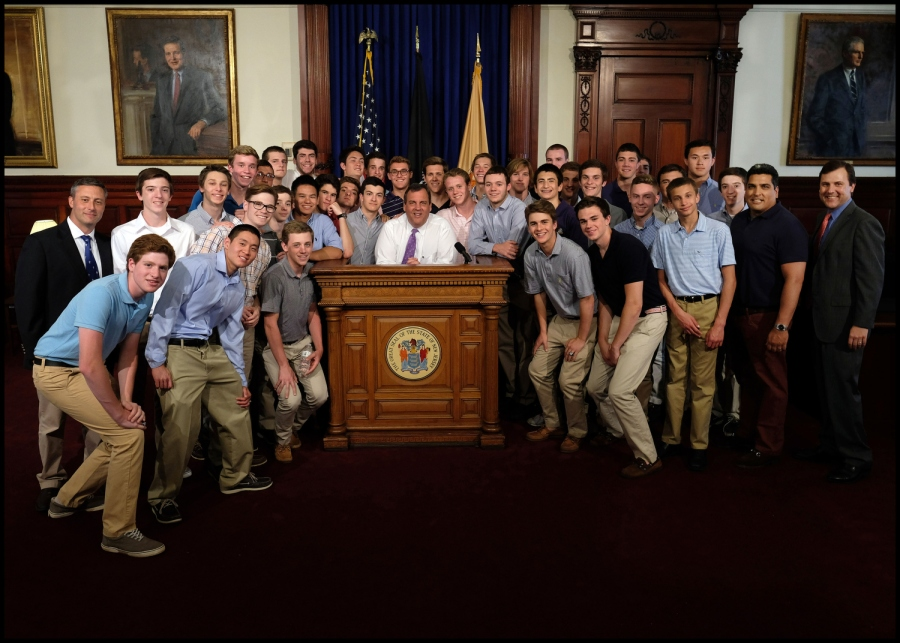 Governor Chris Christie visits with Senator Tom Kean and the Westfield Boys Swim Team in the outer office at the Statehouse in Trenton, N.J. on Thursday, June 2, 2016. (Governor's Office/Tim Larsen)